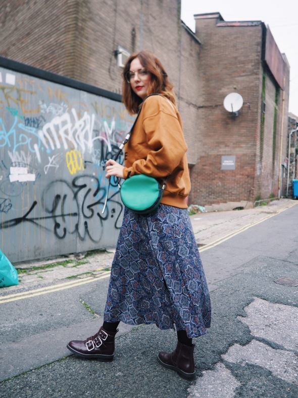 A fashion blogger shares styling suggestions for buckled biker ankle boots